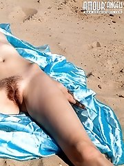 Perfect Teen Beauty Proudly Shows Off Her Stunning Tits And Hairy Pussy On The Seashore.