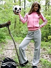 Slender Brunette Girl Takes Off Allmost Everything And Plays And Poses With A Ball In A Woods