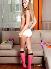 Naughty brunette teen babe masturbates in the kitchen while wearing her sexy pink stockings and heels.