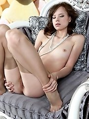 Sexy Slim Girl Wearing Stockings Spreads Her Long Legs Wide To Show You Her Sweet Pussy.