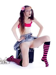 Delectable Teen With An Electro Guitar In Long Striped Socks Stripping And Spreading Legs.
