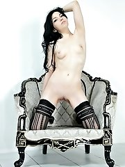 Graceful Teen Brunette Poses In A Chair Demonstrating All The Tasty Parts Of Her Nude Body.