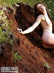 This Amazing Brunette Teen Loves Nothing More Than To Get Down And Dirty With Mud All Over Her Shape