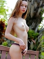 Huge eyes, kissable lips, natural unshaven pussy, amazing body line. Attractive blonde chick show slim body for camera.