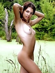 Charming Teen Babe With Juicy Tits And Splendid Dark Hair Posing In The Nude On The Nature.