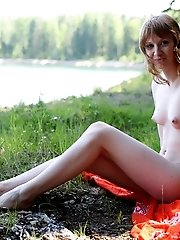 Lovely Teen Girl Revealing Her Tall Svelte Body And Lying On A Ground Being Naked