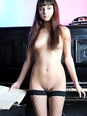 Gorgeous Teenie Wears Nothing But A Hat With A Veil And Fishnet Stockings On Her Nude Body.